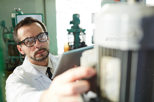 Mature Factory Worker Operating Machines - Stock Photo - Images