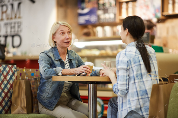 Ladies chatting over cup of coffee - Stock Photo - Images
