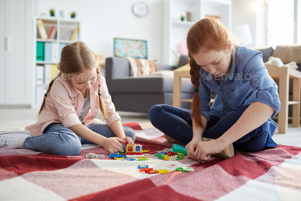 Two Girls Playing at Home - Stock Photo - Images