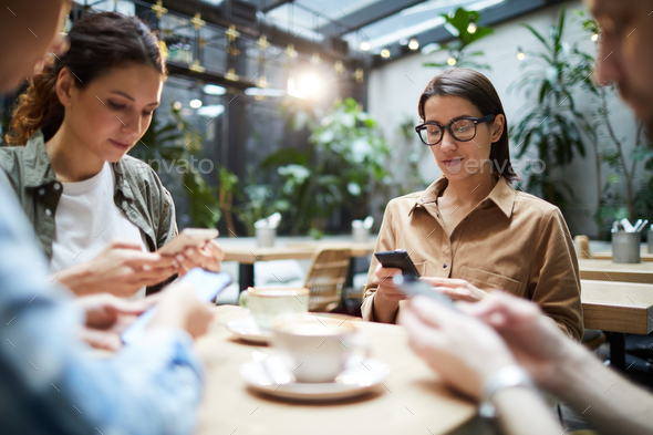 Gathering of gadget-addicted friends - Stock Photo - Images