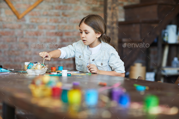 Girl Making Easter Decorations - Stock Photo - Images