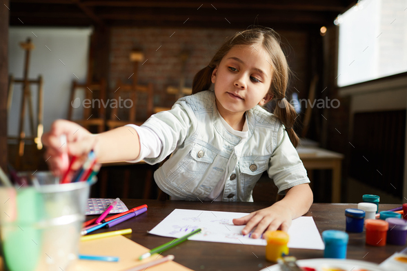 Cute Little Girl Drawing - Stock Photo - Images