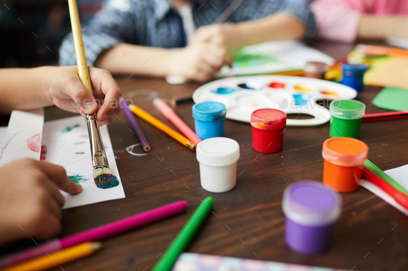 Closeup of Children Painting in Art Class - Stock Photo - Images