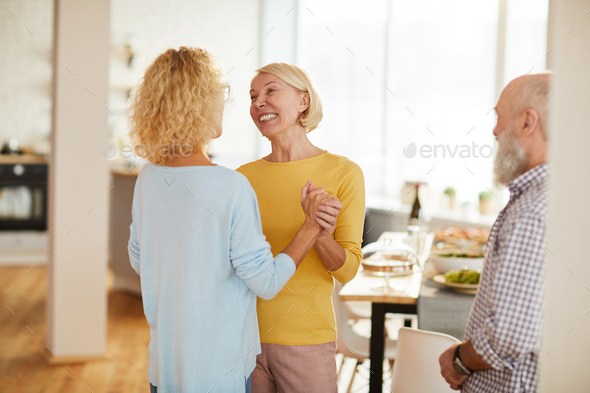Lady friends excited about gathering - Stock Photo - Images