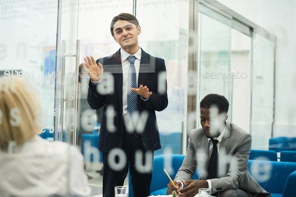 Young Businessman Giving Presentation - Stock Photo - Images