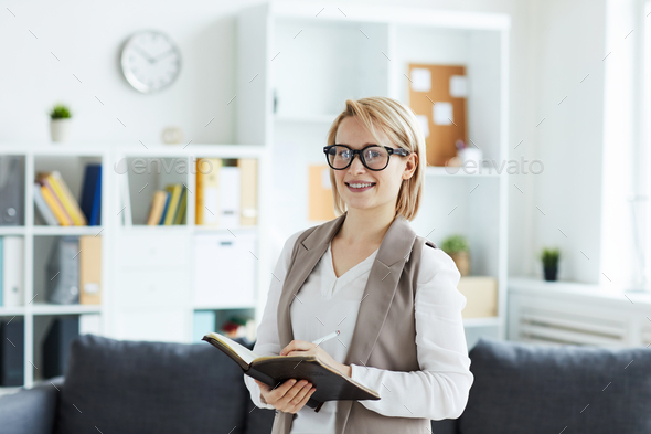 Woman with notepad - Stock Photo - Images