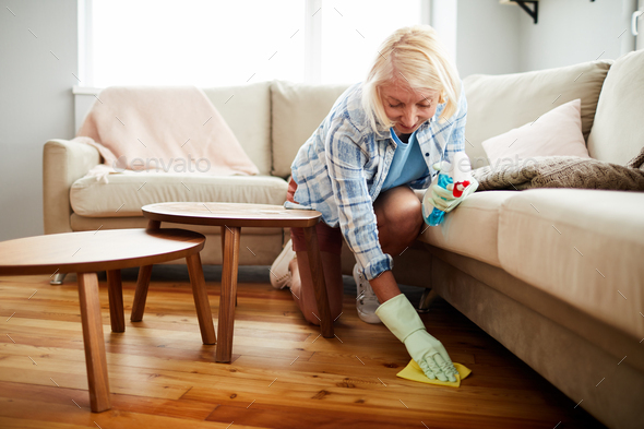 House cleaning worker wiping floor with napkin - Stock Photo - Images