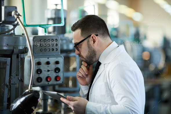 Worker Operating Machines at Plant - Stock Photo - Images