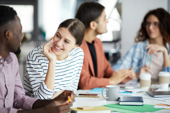Young Woman Talking to Colleague in Meeting - Stock Photo - Images