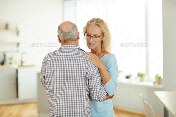 Married mature couple dancing in kitchen - Stock Photo - Images