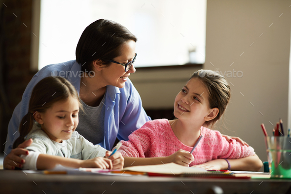 Modern Mother of Two Girls - Stock Photo - Images