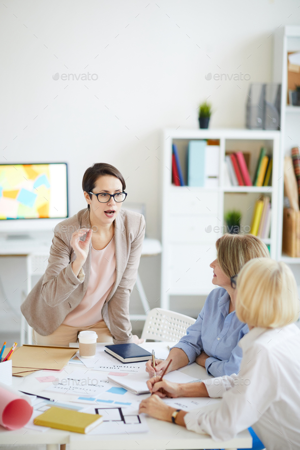 Group of Designers Discussing Project - Stock Photo - Images