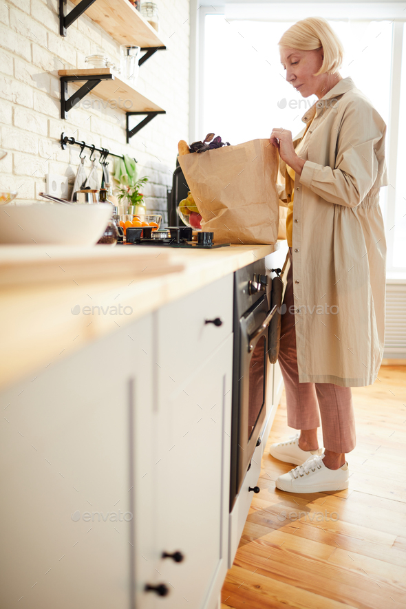 Blond woman after shopping in supermarket - Stock Photo - Images