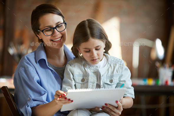 Mother and Daughter Drawing Together - Stock Photo - Images