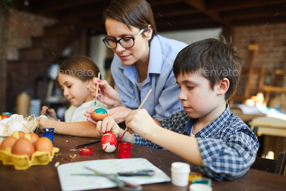 Children Painting Easter Eggs - Stock Photo - Images