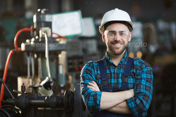 Factory Worker Smiling - Stock Photo - Images