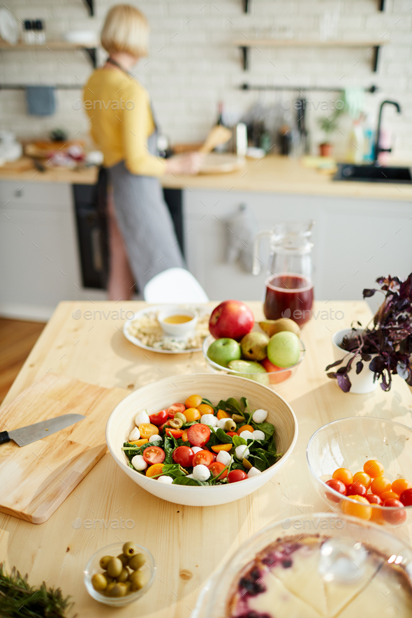 Appetizing vegetable salad on dining table - Stock Photo - Images