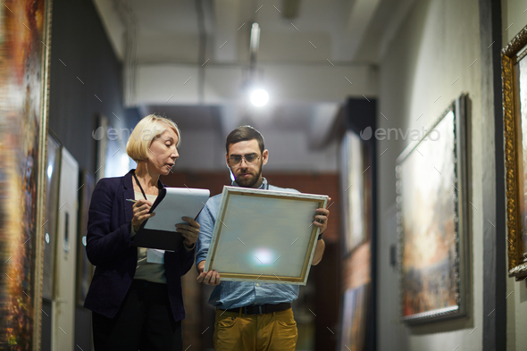 Art Curators in Museum - Stock Photo - Images