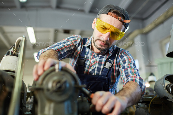 Worker at Metalworking Factory - Stock Photo - Images