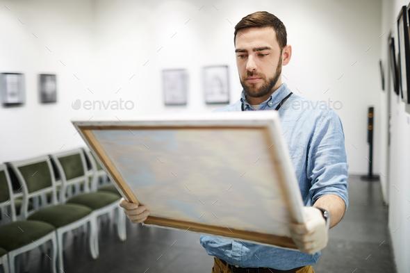 Man Buying Painting - Stock Photo - Images