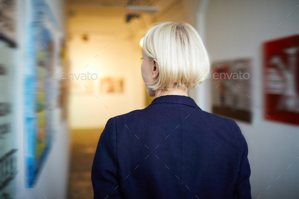 Back View Woman in Art Gallery - Stock Photo - Images