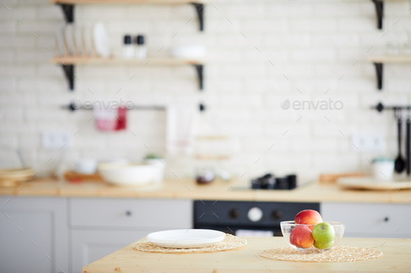 Dining table with fresh apples in bowl - Stock Photo - Images