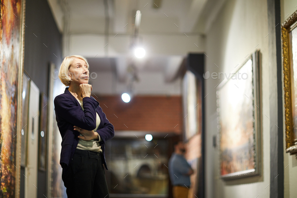 Pensive Woman in Museum - Stock Photo - Images