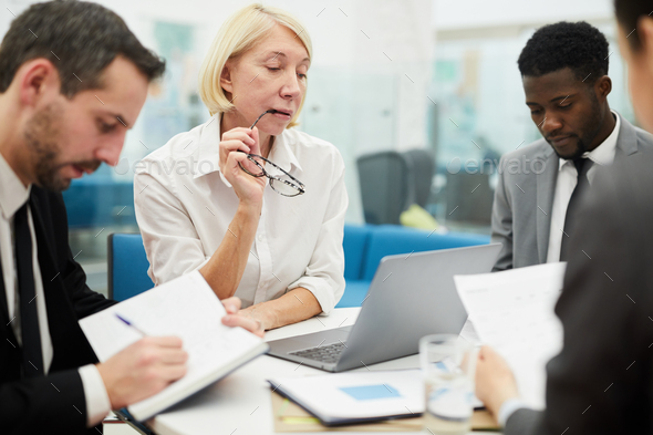 Mature Boss in Meeting - Stock Photo - Images