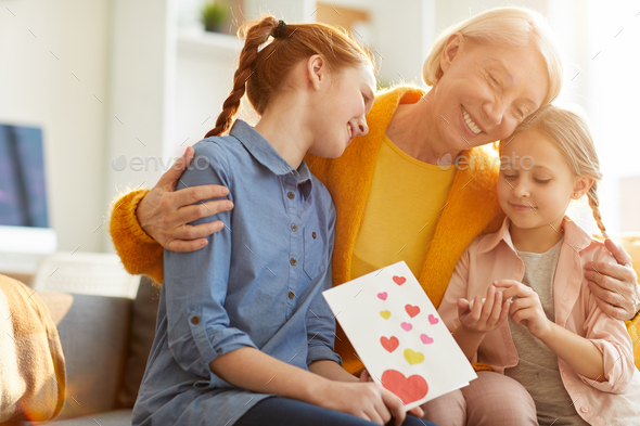 Family Embracing on Mothers Day - Stock Photo - Images