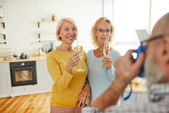 Ladies with flutes posing for camera - Stock Photo - Images