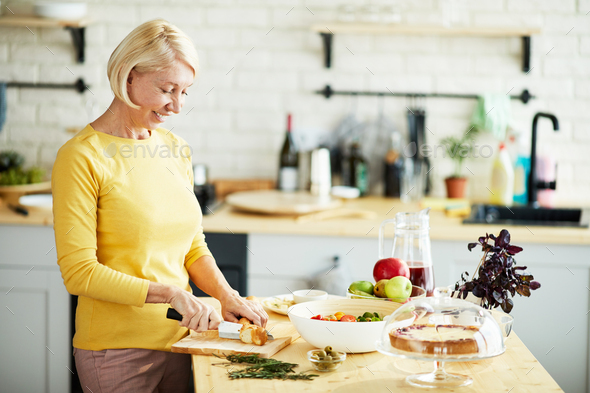 Attractive woman preparing healthy dinner - Stock Photo - Images