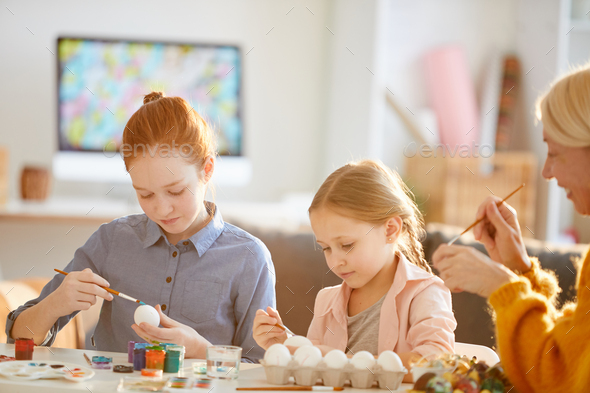Girls Painting Eggs for Easter - Stock Photo - Images