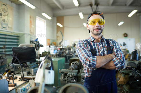 Mature Worker Posing at Industrial Plant - Stock Photo - Images