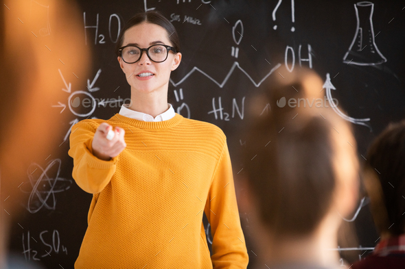 Pointing at student - Stock Photo - Images
