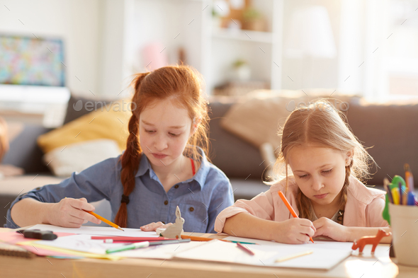 Girls Drawing in Sunlight - Stock Photo - Images