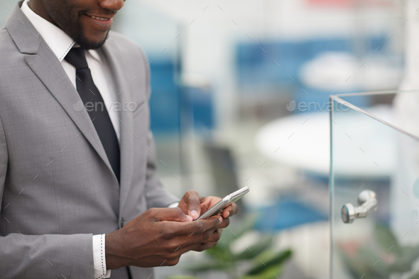 African Businessman Using Smartphone - Stock Photo - Images