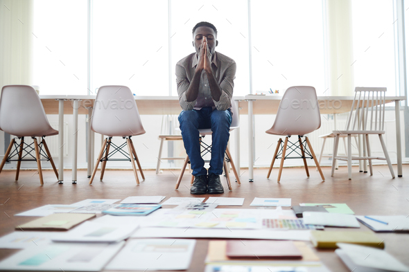 African Businessman Planning Project in Empty Office - Stock Photo - Images
