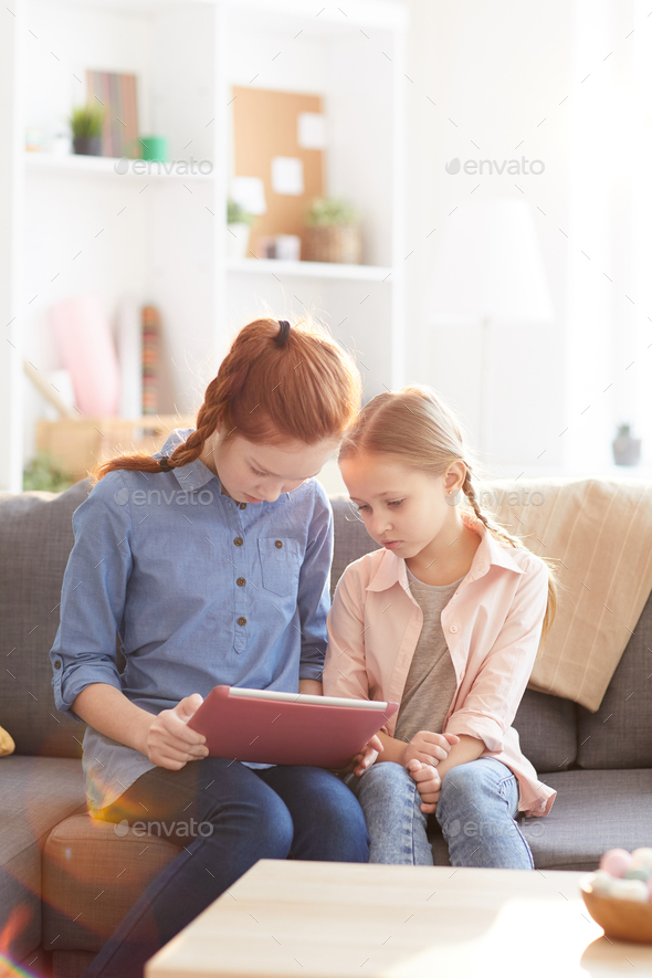Two Sisters Using Tablet - Stock Photo - Images