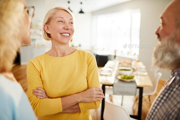 Positive friends chatting in dining room - Stock Photo - Images