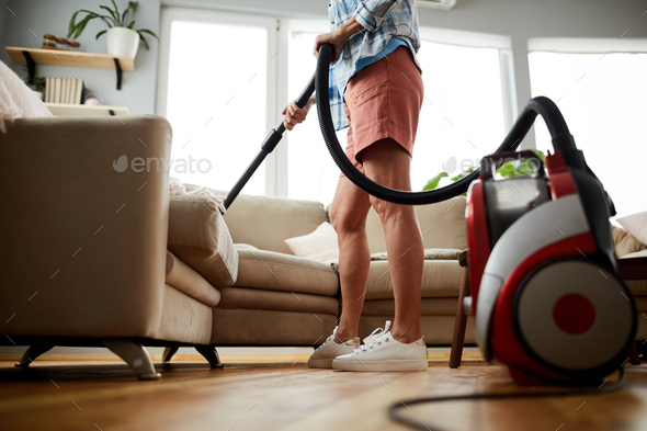 Cleaning sofa with vacuum cleaner - Stock Photo - Images