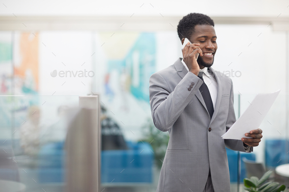 African Businessman Speaking by Phone - Stock Photo - Images