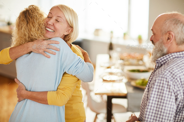 Happy lady glad to see friends - Stock Photo - Images