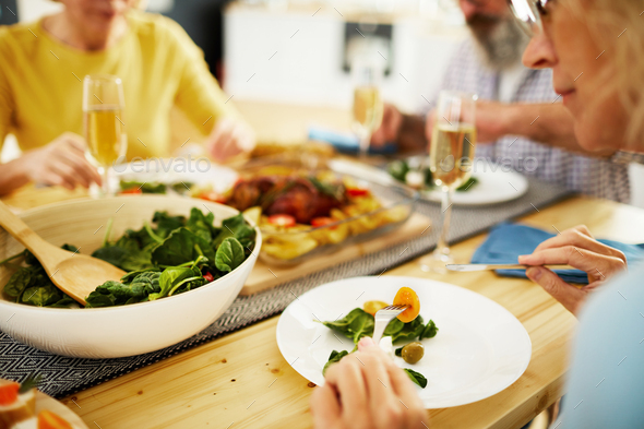 Eating fresh salad at dinner party - Stock Photo - Images
