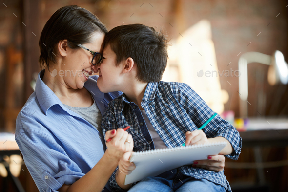 Mother and Son Cuddling - Stock Photo - Images