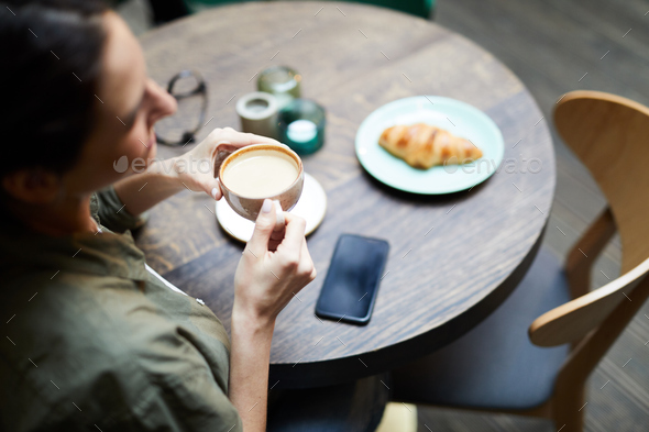 Woman drinking freshly-brewed coffee - Stock Photo - Images