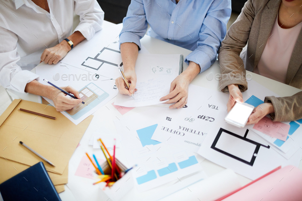 Designers Collaborating on Project - Stock Photo - Images