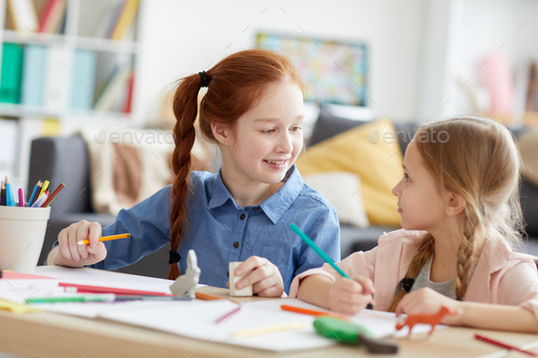 Cheerful Girls Drawing Pictures - Stock Photo - Images