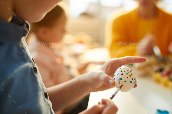 Child Painting Eggs for Easter Closeup - Stock Photo - Images