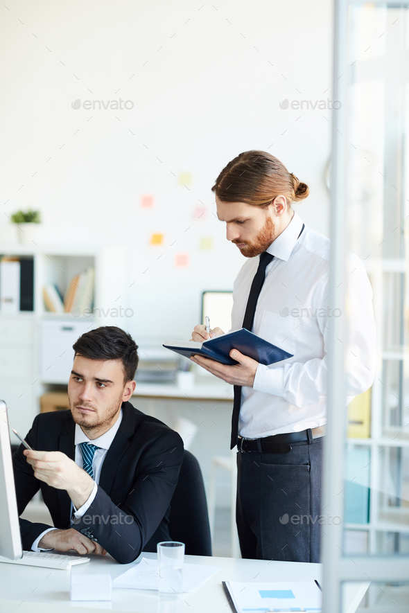 Businessmen working - Stock Photo - Images