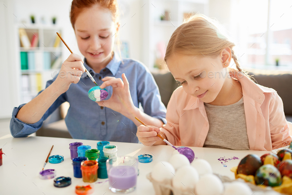 Children Painting Eggs for Easter - Stock Photo - Images